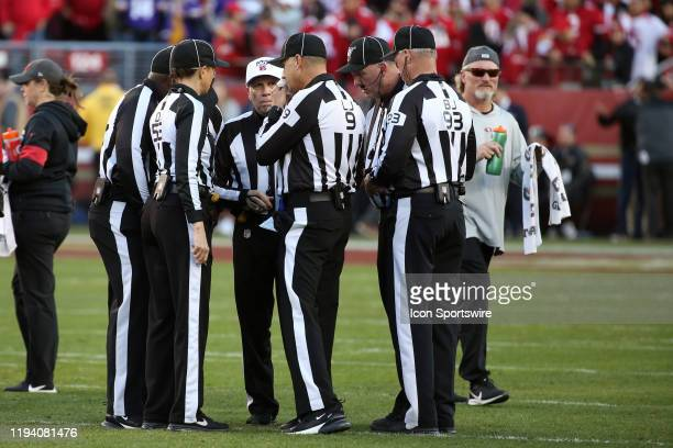 Officials get together during an NFC Divisional Playoff game between the San Francisco 49ers and the Minnesota Vikings on January 11 at Levi's...