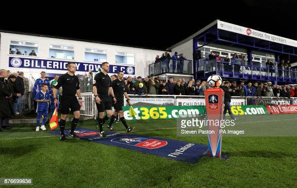 Officials head out onto the pitch