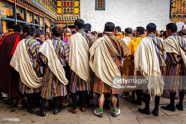 officials in courtyard at paro (rinpung) dzong - paro district stock pictures, royalty-free photos & images
