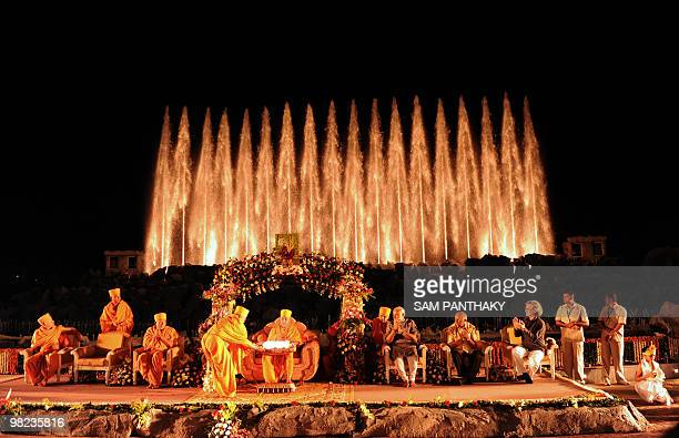 Officials including Chief Minister of the Indian state of Gujarat Narendra Modi applaud as Bochasanwasi Shri AksharPurshottam Swaminarayan Sansthan's...