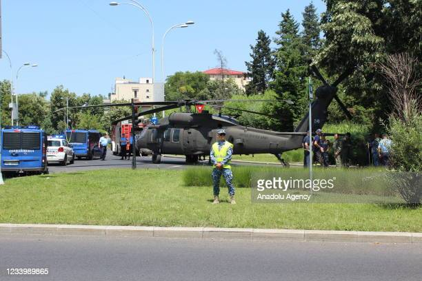 Officials inspect at the site following an emergency landing of US military Black Hawk helicopter at Charles de Gaulle Square in Bucharest, Romania,...