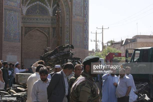Officials inspect the area after a bomb attack at car park of a mosque in Herat Afghanistan on June 6 2017 At least 7 people were killed on the attack