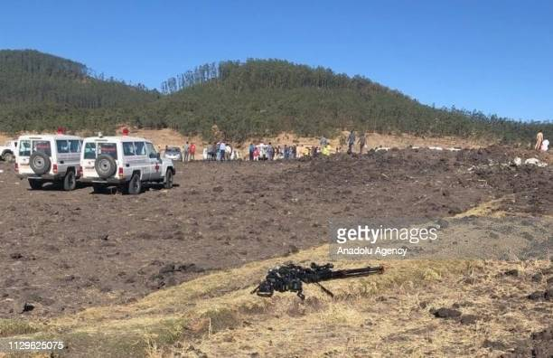 Officials inspect the crash scene after an Ethiopian Airlines passenger plane with 149 passengers and eight crew members on board crashed on Sunday...