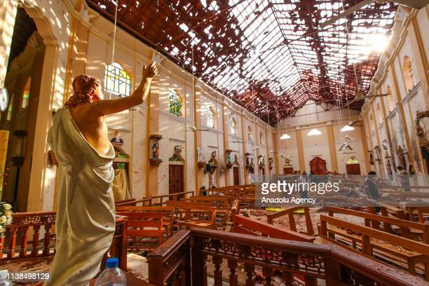 Officials inspect the damaged St Sebastian's Church after multiple explosions targeting churches and hotels across Sri Lanka on April 21 2019 in...