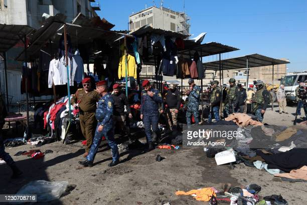 Officials inspect the explosion site after a suicide bombing attack at al-Tayaran Square in Baghdad, Iraq on January 21, 2021. At least 28 people...