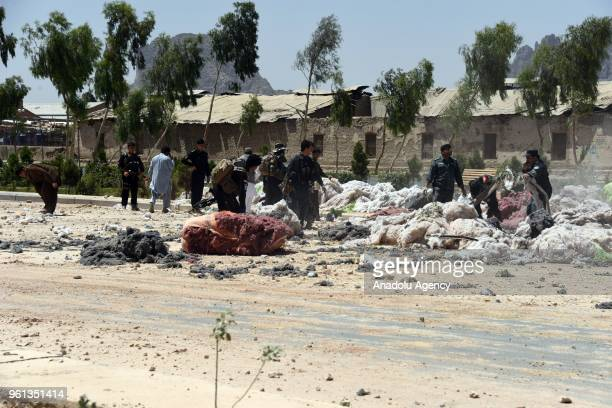 Officials inspect the site after an attack carried out with a bombladen vehicle in Kandvali district of Afghanistan's Kandahar province on May 22...