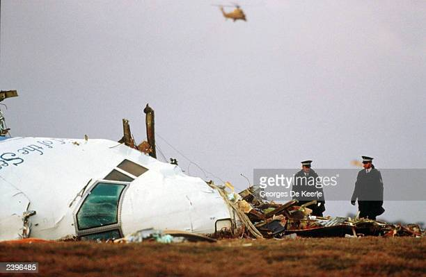 Officials inspect the wreckage of Pan Am flight 103 December 21 1988 in Lockerbie Scotland UN diplomats said August 12 2003 that the US Britain and...