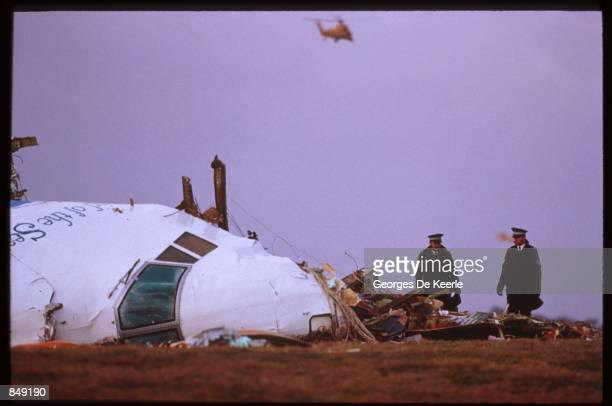Officials inspect the wreckage of Pan Am flight 103 December 21 1988 in Lockerbie Scotland One hundred and eightynine of the two hundred and seventy...