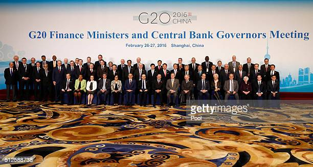 Officials led by host country officials Chinese Finance Minister Lou Jiwei and People's Bank of China Governor Zhou Xiaochuan pose for a family photo...