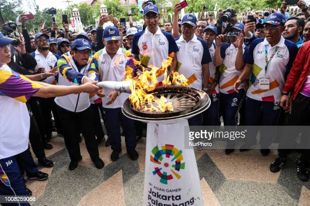 Officials light the torch at the beginning of Asian Games 2018 torch relay ahead of the August 18 September 2 games held at Jakarta and Palembang in...