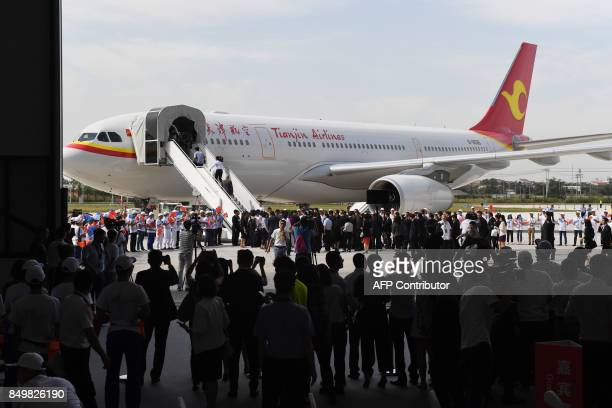 Officials look at the first Airbus A330 plane to be delivered during the inauguration ceremony of the Airbus Long Range Cabin Completion Centre in...