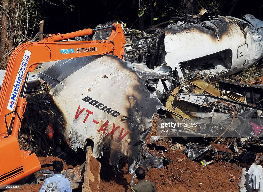 Officials of Air India and the Airports Authority of India work at the plane crash site of the Air India Express Boeing 737-800 in Mangalore on May 24, 2010. Investigators combed the wreckage of an Air India Express jet that crashed into a forested gorge with the loss of 158 lives, searching for the 'black box' data recorder. AFP PHOTO/Dibyangshu SARKAR
