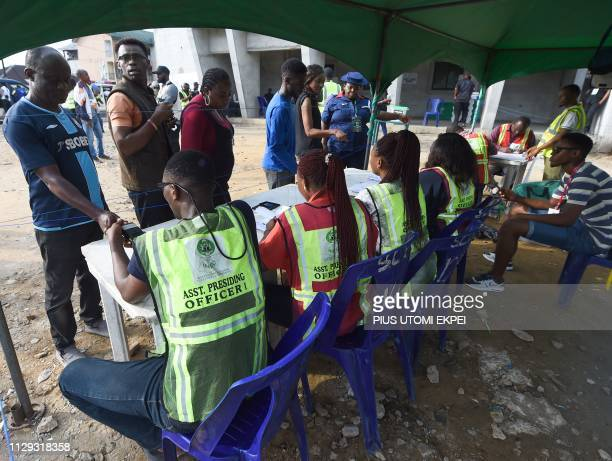 Officials of Independent National Electoral Commission attend to voters at a polling station in Port Harcourt Rivers State on March 9 ahead of voting...