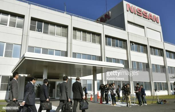 Officials of Japan's transport ministry arrive at a Nissan Motor Co plant in Kanda Fukuoka Prefecture on Nov 1 to assess measures proposed by the...