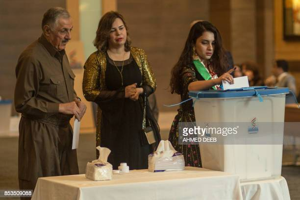 Officials of Kurdistan Regional Government cast their vote in the Kurdish independence referendum at a hotel in Arbil on September 25 2017 Iraqi...