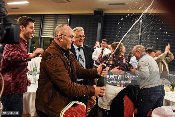 Officials of the Football Federation of Kosovo celebrate in Pristina on May 13 2016 after the FIFA Congress granted membership to Kosovo's Football...