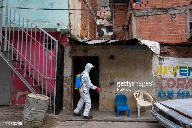 Officials of the mayor's office of Caracas carry out disinfection cleaning after 5 positive cases of coronavirus were confirmed in the El Milagro...