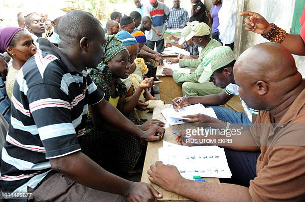 Officials of the Nigerian Independent National Electoral Commission register prospective voters at a voting centre in Magboro on April 2 2011...