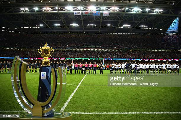 Officials players mascots flag bearers and ball carriers line up as the Webb Ellis trophy is displayed prior to the 2015 Rugby World Cup Pool A match...