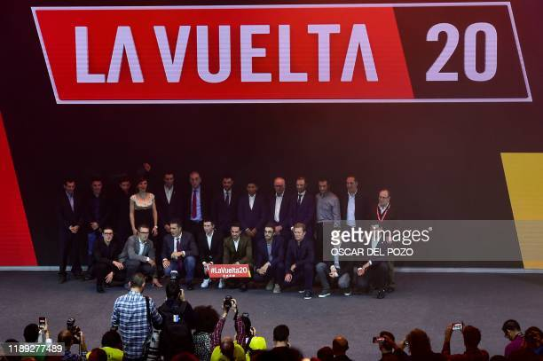 Officials pose for a family picture at the end of the presentation of the 75th La Vuelta cycling tour of Spain 2020, in Madrid on December 17, 2019.