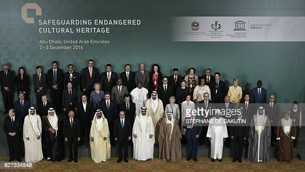 Officials pose for a group picture during the closing ceremony of an international conference on protecting the world's cultural heritage on December...