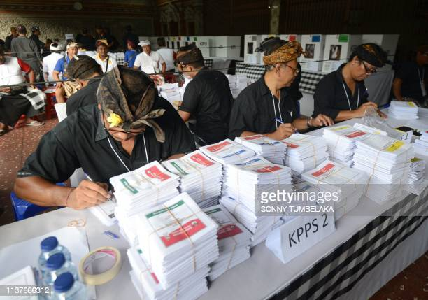 Officials prepare ballot papers at a pooling center during the presidential election in Kuta on Indonesia's resort island of Bali on April 17 2019...