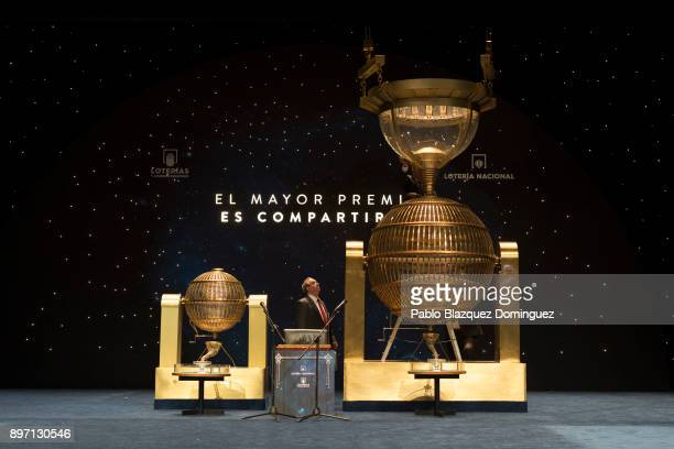 Officials prepare drums with ball bearing before the start of the draw of Spain's Christmas lottery named 'El Gordo' at the Teatro Real on December...