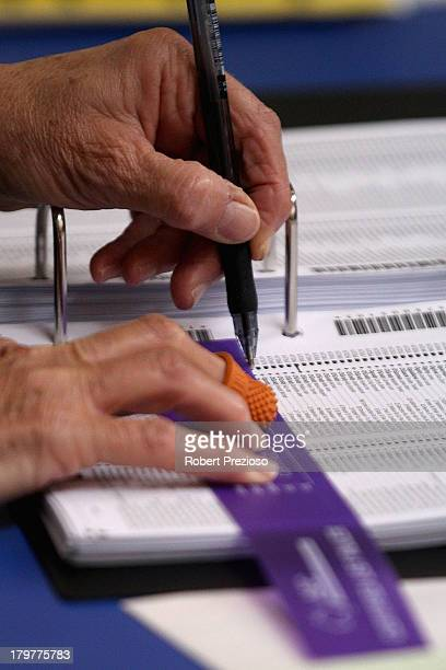 Officials prepare voting papers for members of the public to vote in the electorate of Sturt on election day on September 7 2013 in Adelaide...