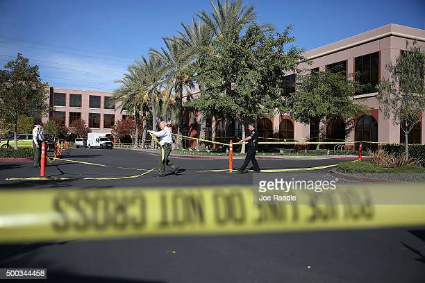 Officials put up police tape in front of the builiding at the Inland Regional Center were 14 people were killed on December 7 2015 in San Bernardino...