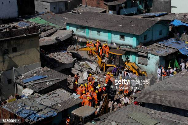 NDRF officials removing debris after a building collapsed at Nai Basti Bhiwandi on November 24 2017 in Mumbai India Three people were killed and...