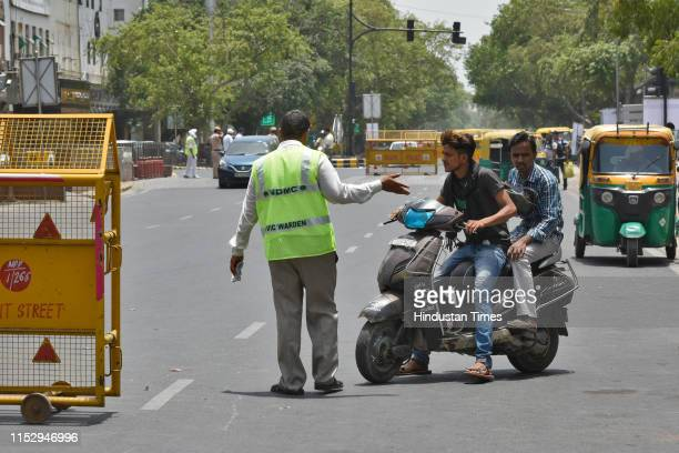 Officials seen at Connaught Place, on June 30, 2019 in New Delhi, India. The New Delhi Municipal Council on Sunday starts its trial run to regulate...