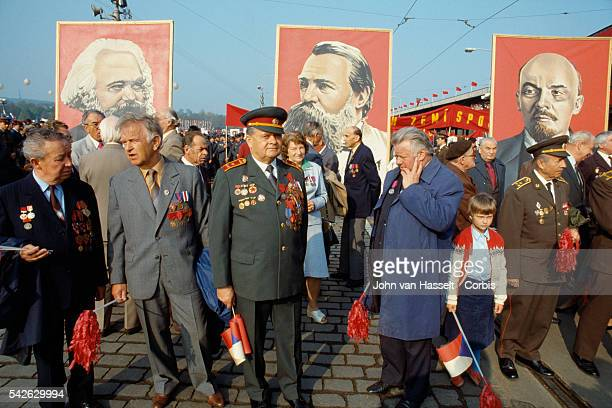 Officials stand in front of portraits of Karl Marx Lenin and Engels