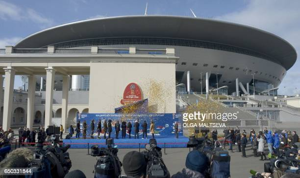 Officials take part in a ceremony marking 100 days until the start of the FIFA Confederations Cup 2017 at the new football stadium at Krestovsky...