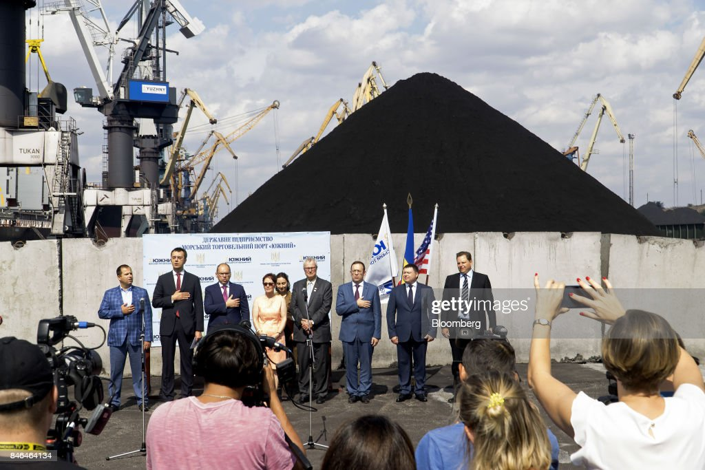 Officials take part in a dockside ceremony to mark the arrival of anthracite coal from U.S. supplier XCoal Energy & Resources LLC, for state energy firm Centrenergo PJSC, at Yuzhny Port, near Odessa, Ukraine, on Wednesday, Sept. 13, 2017. A Pennsylvania company will send 700,000 tons of coal to Ukraine in a deal the administration of President Donald Trump heralded as an important tool to undercut the power Russia has over its European neighbors. Photographer: Vincent Mundy/Bloomberg via Getty Images