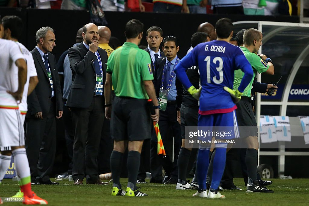 CONCACAF officials talk with the referees as players from Panama walk off the field in protest after a last minute penalty was awarded in the last minute of the 2015 CONCACAF Gold Cup Semi Final between Panama and Mexico at Georgia Dome on July 22, 2015 in Atlanta, Georgia.
