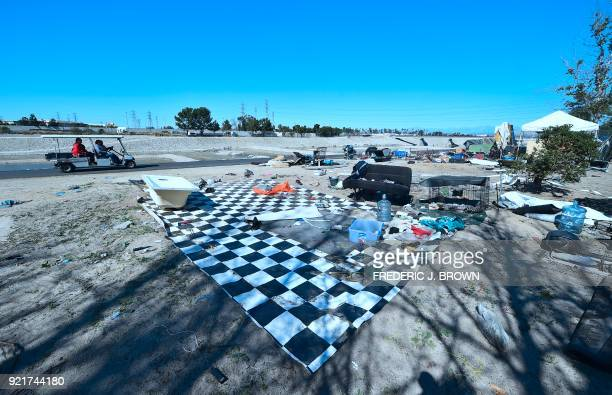 Officials tour the homeless encampment beside the Santa Ana River from a golf cart on February 20 2018 in Anaheim California Officials in Orange...