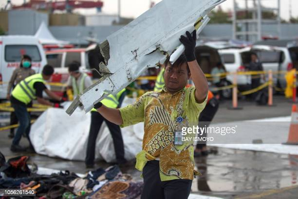 Officials transfer recovered debris from the illfated Lion Air flight JT 610 for further examination by Indonesia's National Transportation Safety...