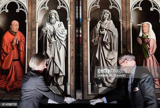 Officials unveil the restored exterior panels of 'The Adoration of the Mystic Lamb' an altar piece painted by the Van Eyck brothers in 1432 at Saint...