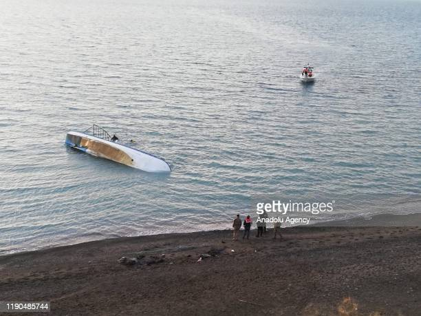 Officials wait at shore of Van Lake after a boat carrying irregular migrants sank on December 26, 2019 in Van, Turkey. 7 irregular migrants lost...