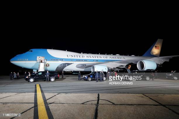 Officials wait for US President Donald Trump and US First Lady Melania Trump to disembark from Air Force One after landing at Stansted Airport,...