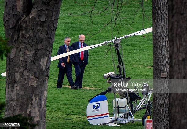 Officials walk past a gyrocopter that has landed on the west front lawn of the Capitol on April 2015 in Washington DC
