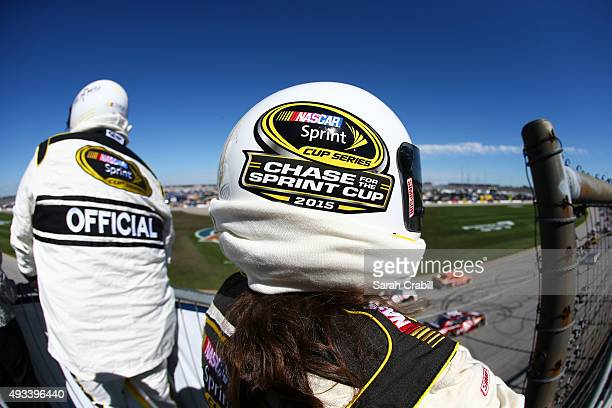 Officials watch the track during the NASCAR Sprint Cup Series myAFibRiskcom 400 at Chicagoland Speedway on September 20 2015 in Joliet Illinois