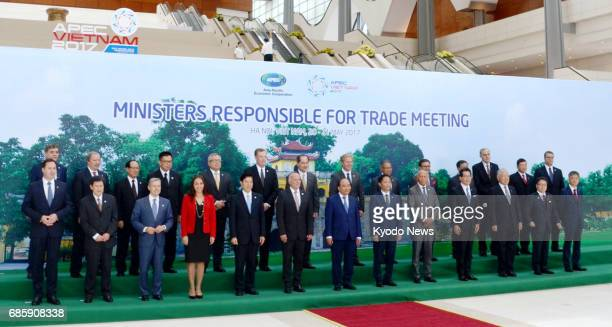 Officials who attended trade ministerial talks at the AsiaPacific Economic Cooperation forum pose for a photo in Hanoi Vietnam on May 20 2017 ==Kyodo