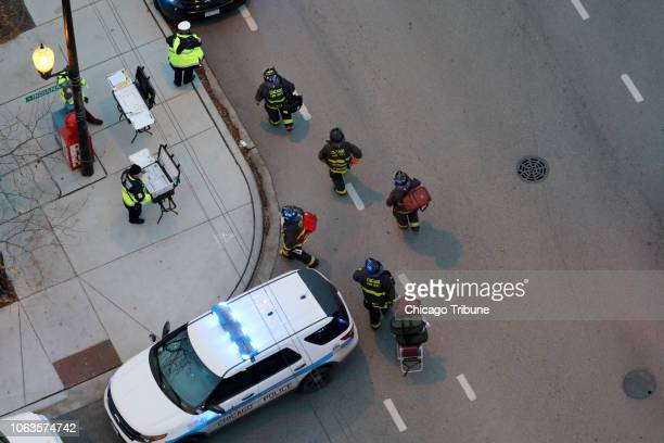 Officials work at an entrance at Mercy Hospital Nov 19 2018 Multiple people including a Chicago police officer were reported shot at the Near South...