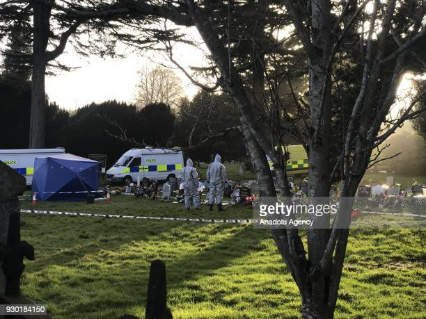 Officials work at the grave site of former Russian spy Sergei Skripal's wife as the grave is opened for autopsy within the investigation carried out...