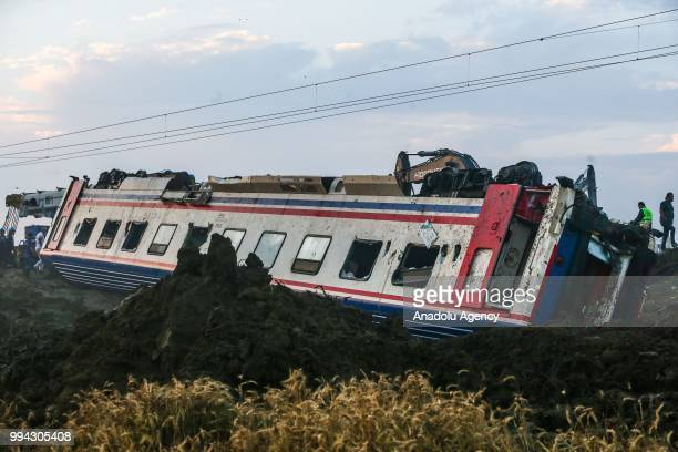 Officials work at the scene after several bogies of a passenger train derailed at the Sarilar village of Tekirdags Corlu district on July 09, 2018....