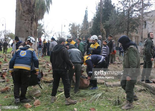 Officials work at the site after the consecutive bomb attacks with two bombladen vehicles in Idlib city centre Syria on February 18 2019 Nine...