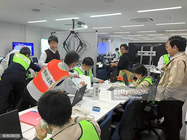 Officials work to gather information at the Fukushma Prefecture Disaster Management Center after the magnitude74 earthquake hit offshore Fukushima on...