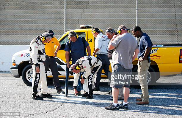 Officials work to repair the track during the NASCAR KN Pro Series East Kevin Whitaker Chevrolet 140 at Greenville Pickens Speedway on September 5...