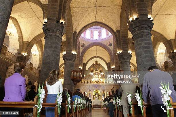 OFFICIALSSyrian Christians gather as they take part in the Sunday service at the Melkite Greek Catholic Church of Our Lady AlNiyah in Damascus on May...